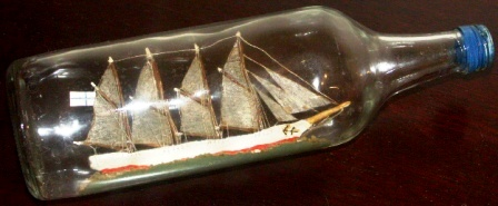 Early 20th century sailor-made ship model housed in bottle depicting the 4-masted Finnish schooner HELENA of RAUMA