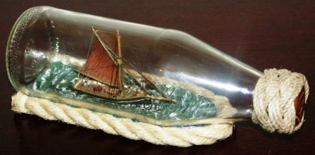 20th century ship model housed in bottle depicting a British cutter, built in Brixham in early 20th century. Signed GF (Göran Fors).