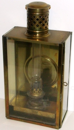 19th century kerosene bulkhead lamp in brass. With detachable burner/container.