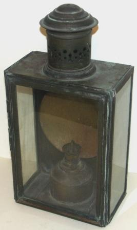 Late 19th century kerosene bulkhead lamp in brass. With detachable burner/container.