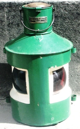 "Early 20th century painted ""all-in-one"" port and starboard light. Complete with kerosene burner. Sold by Herman Gotthardt, Malmö."