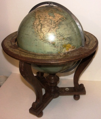 Early 20th century Columbus globe with compass. Oak stand. Imported by Edwin Hammar, Stockholm. (Requires minor attention).
