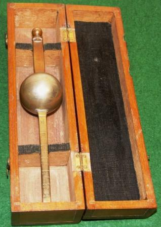 Late 19th century marine hydrometer. In original mahogany case incl hydrometer tables.