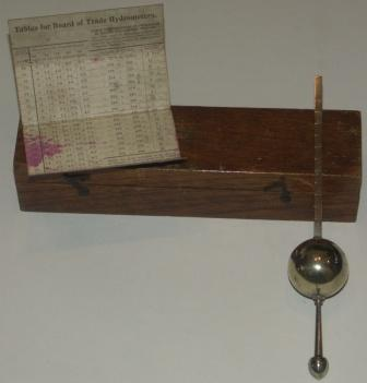 Late 19th century silver-plated marine hydrometer. In original mahogany case. Incl hydrometer tables by J.W. Gillie.