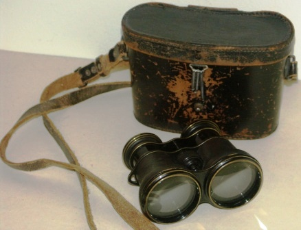 Early 20th century anonymous binocular in black-lacquered brass, leather-bound. In original leather case.