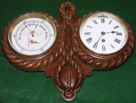 Early 20th centuryships clock and barometer with Royal Yacht Club emblem. Cased in decoratively carved wooden panel.