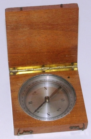 Early 20th century pocket compass mounted in wooden case.