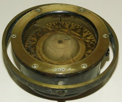 Early 20th century compass in brass, made by Newman & Field Ltd., Birmingham. No 200. Mounted in gimbal.