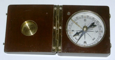 Early 20th century pocket compass in wooden box.