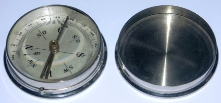 Early 20th century pocket compass in stainless metal box.