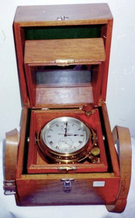 20th century two-day marine chronometer mounted in gimbals in original mahogany case fitted with brass carrying handles. Made by Thomas Mercer. Incl transportation case.