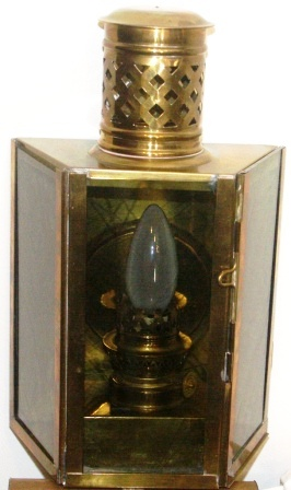 Early 20th century electrified bulkhead lamp in brass.