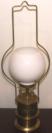 Early 20th century carbide lamp made of brass, with glass-shade. Marked with Three Crowns, Typ 4 and No 65. Made by MF-AB Eskilstuna, Sweden.
