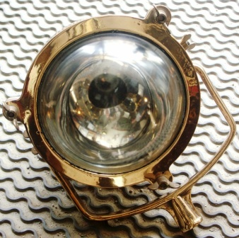 20th century electrified deck light in copper and brass. Complete with mounting bracket.