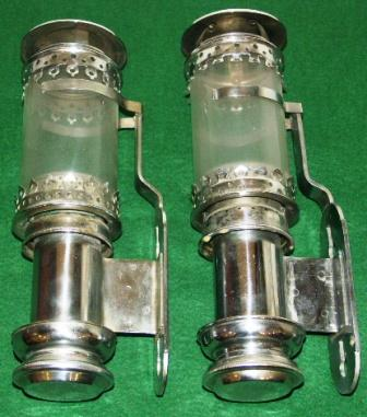 A pair of early 1920's chrome-plated sconces for candles.