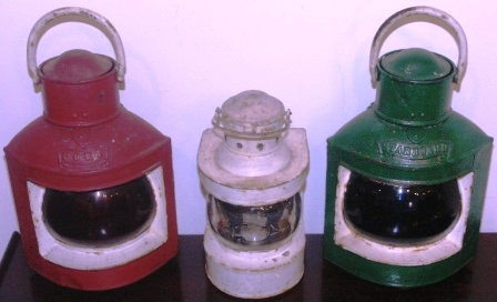 Set of early 20th century kerosene port, starboard and masthead lights. Made of sheet metal. With detachable burner/container.