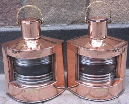 Pair of 20th century navigation lanterns made by C.M. Hammar, Göteborg and marked with three crowns, G35762 and G35763. The oil burning lamps are housed in copper cases, marked BABORD and STYRBORD.