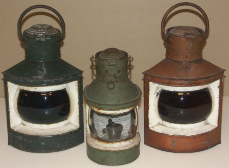 Set of early 20th century port, starboard and masthead navigation lights. Made of painted sheet metal. Complete with kerosene burners.