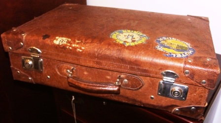 Leather suitcase, used onboard the liner T.S. DROTTNINGHOLM (SAL, SWEDISH AMERICAN LINE) in 1939. Belonged to Martin G. Winberg, Stockholm, cabin 341, travelling April 29, 1939