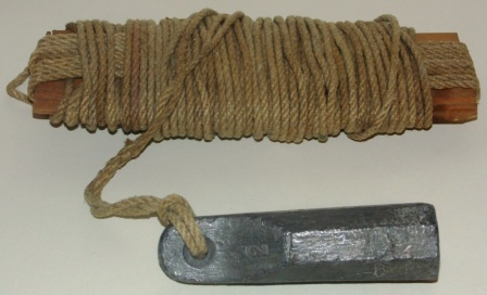 "Late 19th century plumb-line. Wood, hemp-rope & lead weight. Marked ""2""."