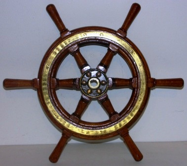 1920's/1930's six-spoked ships wheel. Teak, brass band and hub.