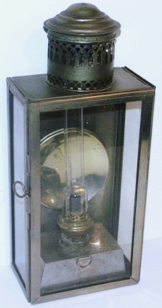 Early 20th century chrome-plated kerosene bulkhead lamp. With detachable burner/container