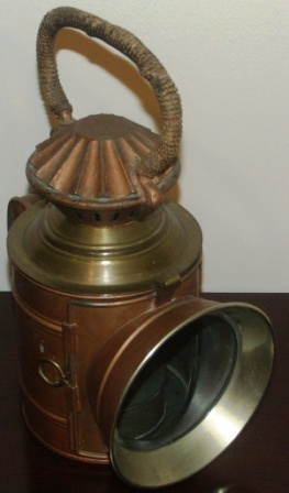 Early 20th century hand-held kerosene lamp. Made of sheet metal and brass by C.M. Hammar, Gothenburg Sweden.
