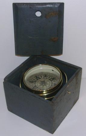 Late 19th century dry card compass made of brass. Mounted in gimbals, wooden case.