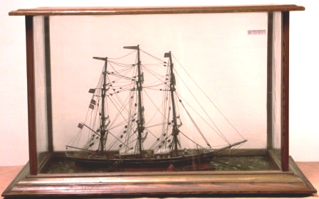 Early 20th century sailor-made diorama. Depicting the British full-rigged ship MARY at anchor together with approaching tug-boat. Mounted in origianal wooden case.