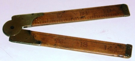 Early 20th century folding rule made of wood and brass