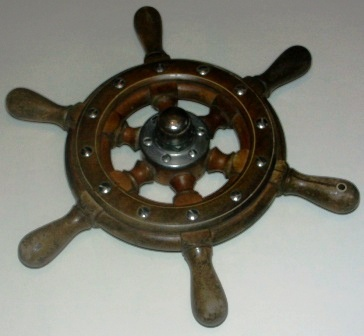 20th century six-spoked teak ships wheel. With central crome-plated brass hub.