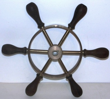 20th century six-spoked brass steering wheel with teak handles.