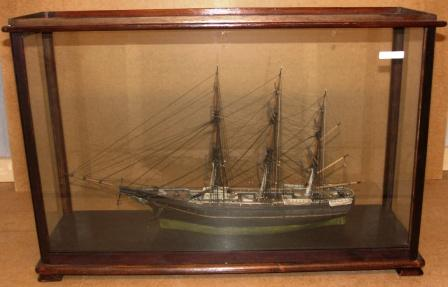 19th century sailor-made fullrigged model. Mounted in glass case.