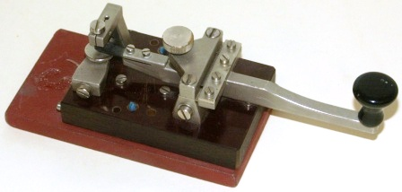 20th century telegraph / morse key, made of metal and mounted on bakelite / metal base
