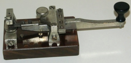 20th century telegraph / morse key, made of metal and mounted on bakelite base.