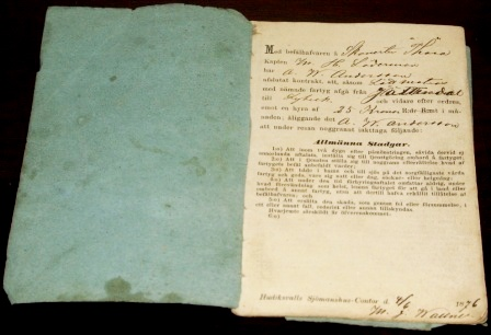 Employment contract and salary booklet. Agreement between the captain Läderman and the ordinary seaman Andersson onboard the schooner Thora. Signed and dated Hudiksvalls Sjömanshus-Contor June 4, 1876.