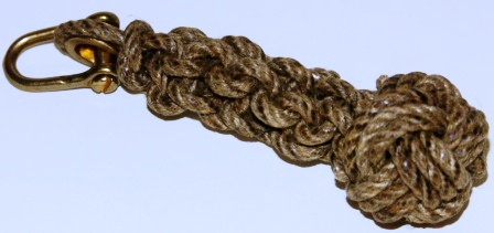 Bell-rope made of tarred rope. Incl brass fittings.