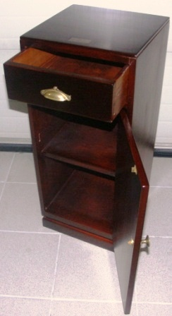 Small mahogany cupboard from the Italian tanker M/C Orlando. Drawer, door and shelf.