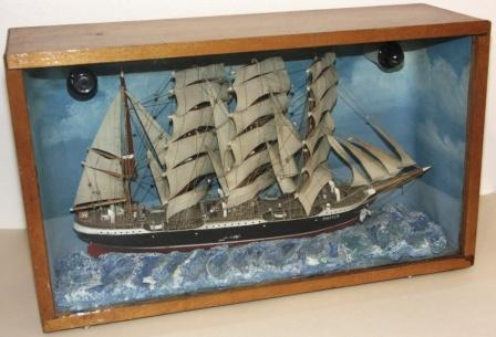 Early 20th century sailor-made illuminated diorama. Depicting the well-known four-masted barque PAMIR. Mounted in origianal case.