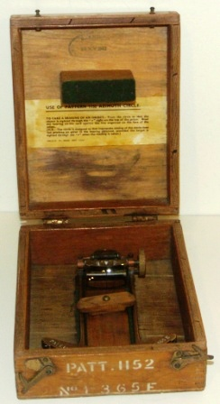 WWII brass Azimuth circle with adjustable prism and filter for compass reading. In original wooden box. Dated November 28, 1942.