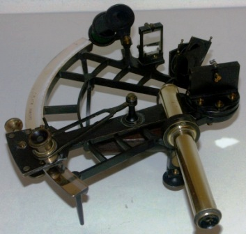 WWII sextant made by C. Plath, Hamburg. Brass frame, silver scale and vernier with a magnifier to assist scale readings. One telescope and sun-filters.