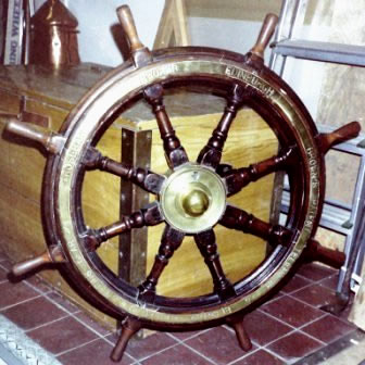 Late 19th century eight-spoked mahogany ships wheel with double brass bands and central brass hub