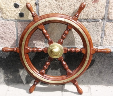 20th century six-spoked ships wheel. With double brass bands and central brass hub.