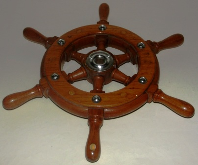 Mid 20th century six-spoked teak steering wheel.