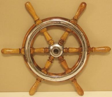 1920's six-spoked ships wheel. Teak, chrome-plated brass band.