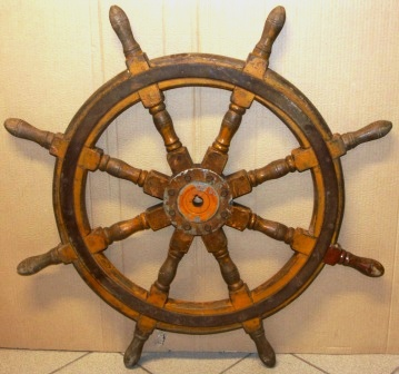 Early 20th century eight-spoked ships wheel. Oak, metal band and hub.