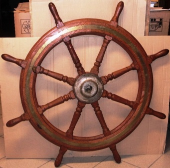 Early 20th century eight-spoked ships wheel. Stained oak, brass band and handle, metal hub.