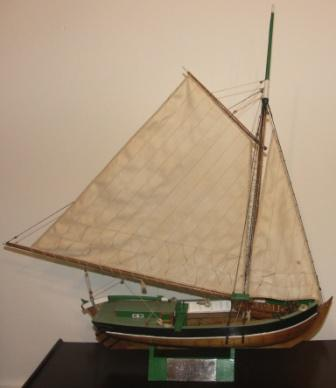 20th century built model depicting a Swedish wooden cargo boat, as used in Stockholm's archipelago for transportation of sand. Built by Albert Pettersson (Alpe), Norrtälje, in 1970.