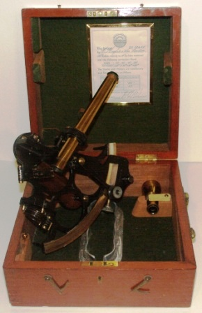 Early 20th century sextant in original mahogany case. Made by Hughes & Son London. No 17438. Sold by C. L. Malmsjö & Co. Göteborg. Circle frame, silver scale, magnifying glass, three telescopes and sun-filters. Last examined and corrected October 28, 1931.