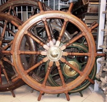 Early 20th century ten-spoked ships wheel in teak. With double brass bands and central brass hub. Made by Brown Bros. & Co Ltd Edinburgh.
